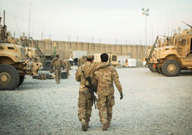 FILE PHOTO: A U.S. soldier from the 3rd Cavalry Regiment walks with the unit's Afghan interpreter before a mission near forward operating base Gamberi in the Laghman province of Afghanistan December 11, 2014.