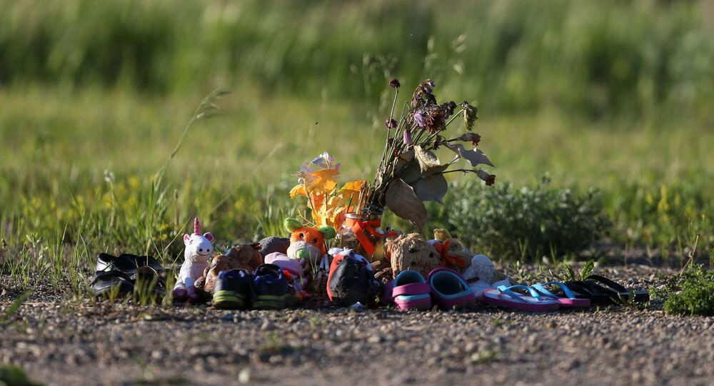 Shoes, stuffed animals and other offerings are seen at the site of the former Brandon Indian Residential School where researchers, partnered with the Sioux Valley Dakota Nation, located 104 potential graves in Brandon, Manitoba, Canada, June 12, 2021.