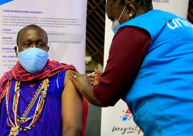 Kenyan tour guide, Daniel Ole Kissipan, receives the AstraZeneca/Oxford vaccine against the coronavirus disease (COVID-19) under the COVAX scheme, in Nairobi, Kenya, April 27, 2021.