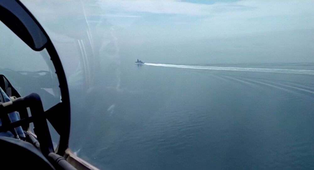 A still image taken from a video released by Russia's Defence Ministry allegedly shows British Royal Navy's Type 45 destroyer HMS Defender filmed from a Russian military aircraft in the Black Sea, June 23, 2021.