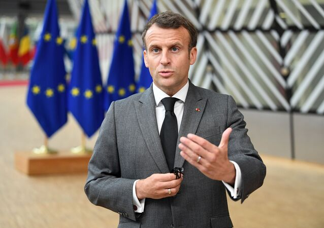France's President Emmanuel Macron addresses the media as he arrives on the first day of the European Union summit at The European Council Building in Brussels, Belgium June 24, 2021.