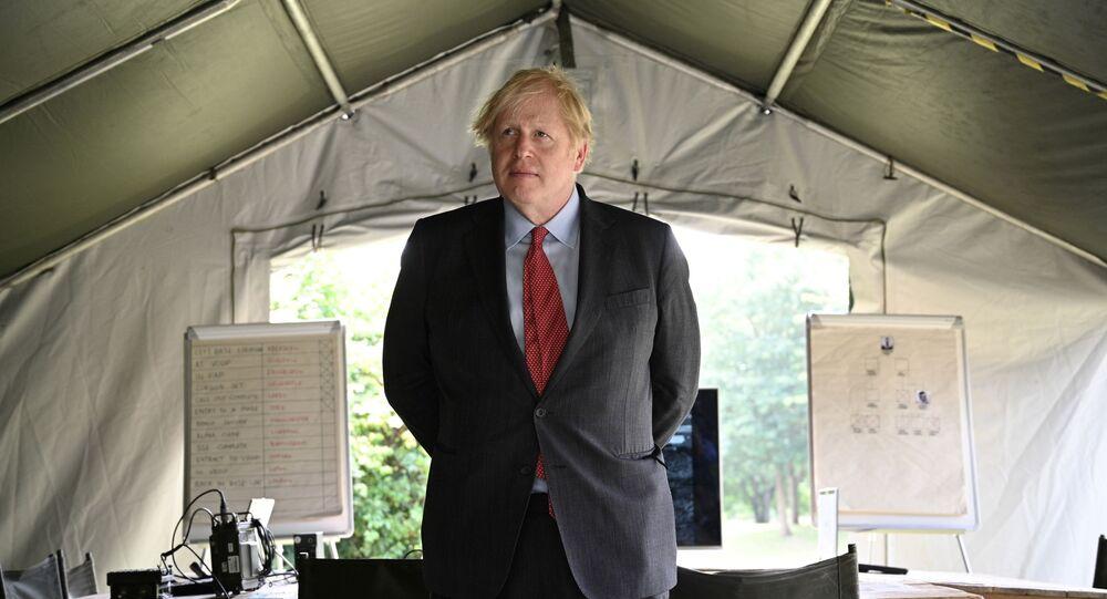 Britain's Prime Minister Boris Johnson meets soldiers of the new Ranger Regiment during a visit to mark Armed Forces Week, at the Aldershot Garrison in Aldershot, Britain June 24, 2021.