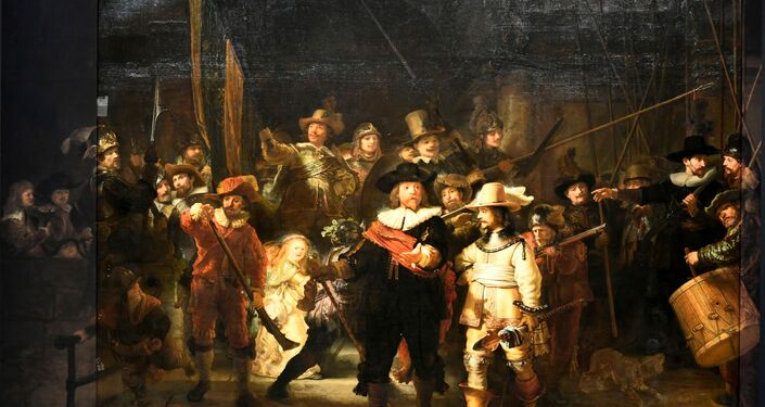 Rembrandt's famed Night Watch is seen back on display for the first time in 300 years, in what researchers say is its original size, with missing parts temporarily restored in an exhibition aided by artificial intelligence at Rijksmuseum in Amsterdam, Netherlands June 23, 2021.