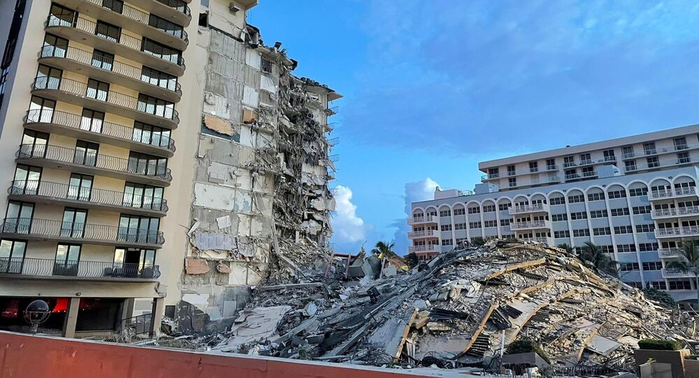 A view shows a partially collapsed building in Surfside, near Miami Beach, Florida, U.S., June 25, 2021