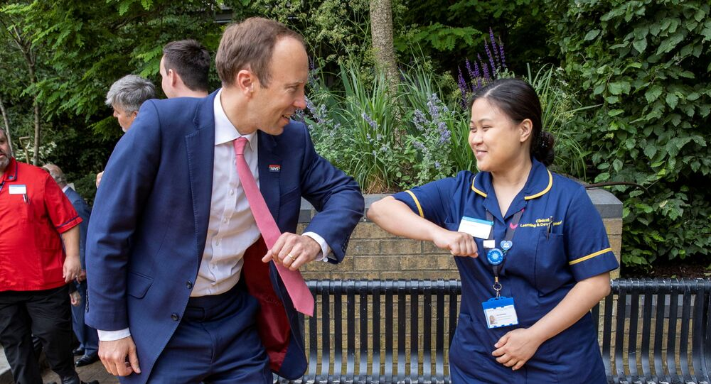 Britain's Health Secretary Matt Hancock meets NHS staff during a visit to Chelsea and Westminster Hospital in London, Britain on 17 June 2021.