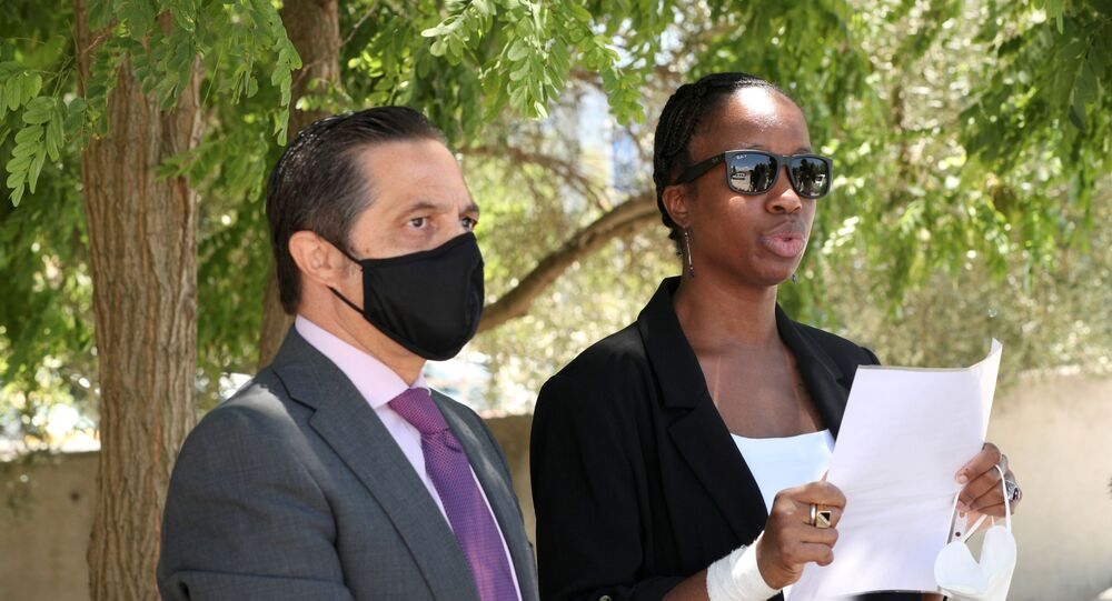 Janice McAfee, a wife of John McAfee, flanked by her lawyer Javier Villalba, speaks to media as she leaves the Brians 2 prison where her husband was found dead in his prison cell after the Spanish high court had authorised his extradition to the U.S., in Sant Esteve Sesrovires, Spain June 25, 2021.