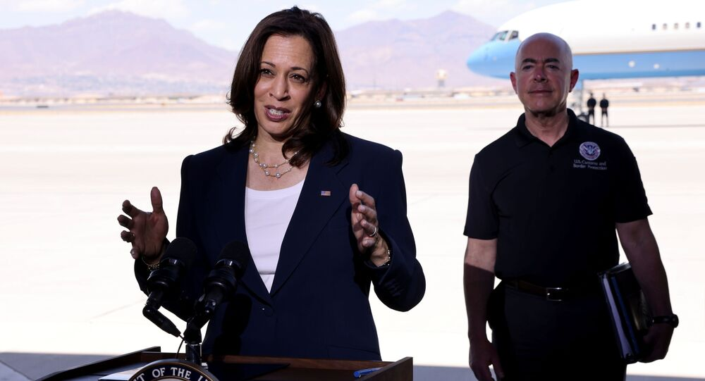 U.S. Vice President Kamala Harris delivers remarks next to Department of Homeland Security (DHS) Secretary Alejandro Mayorkas, before boarding Air Force Two at El Paso International Airport in El Paso, Texas, U.S., June 25, 2021.