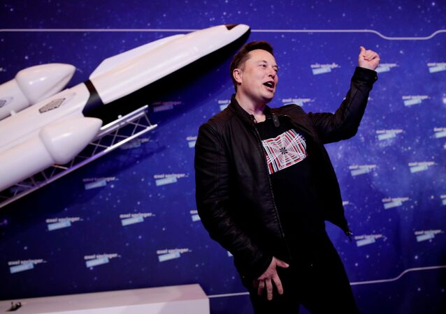 SpaceX owner and Tesla CEO Elon Musk gestures after arriving on the red carpet for the Axel Springer award, in Berlin, Germany, December 1, 2020.