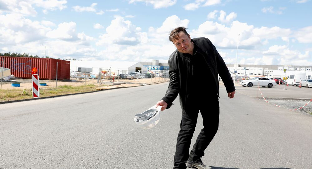 SpaceX founder and Tesla CEO Elon Musk holds a helmet as he visits the construction site of Tesla's gigafactory in Gruenheide, near Berlin, Germany, May 17, 2021.