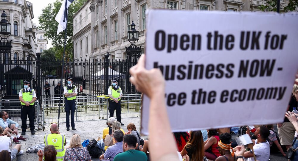 Police officers stand guard during an anti-lockdown and anti-vaccine protest, amid the coronavirus disease (COVID-19) pandemic, outside Downing Street, London, Britain, June 14, 2021.