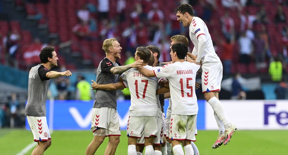 Denmark players celebrate after the match