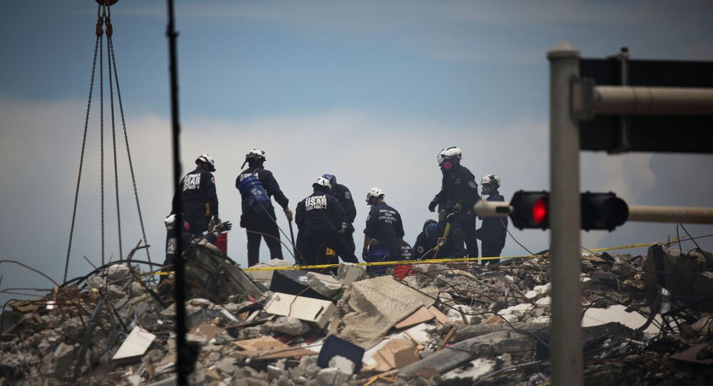 Rescue personnel continues search and rescue operations for survivors of a partially collapsed residential building in Surfside, near Miami Beach, Florida, U.S. June 26, 2021.