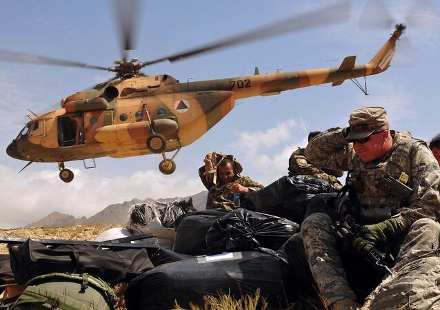 Humanitarian Aid Delivered to Afghan Village by NATO Training Mission-Afghanistan