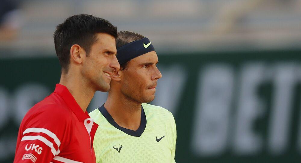 Serbia's Novak Djokovic with Spain's Rafael Nadal before their semi final match