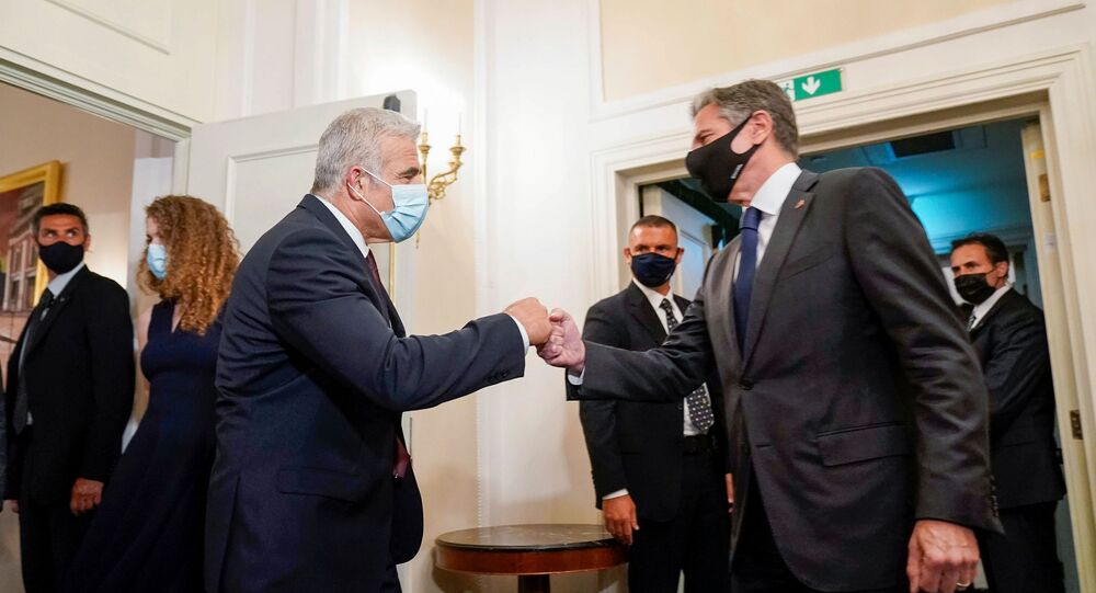 U.S. Secretary of State Antony Blinken greets Israeli Foreign Minister Yair Lapid during their meeting in Rome, Italy, June 27, 2021.