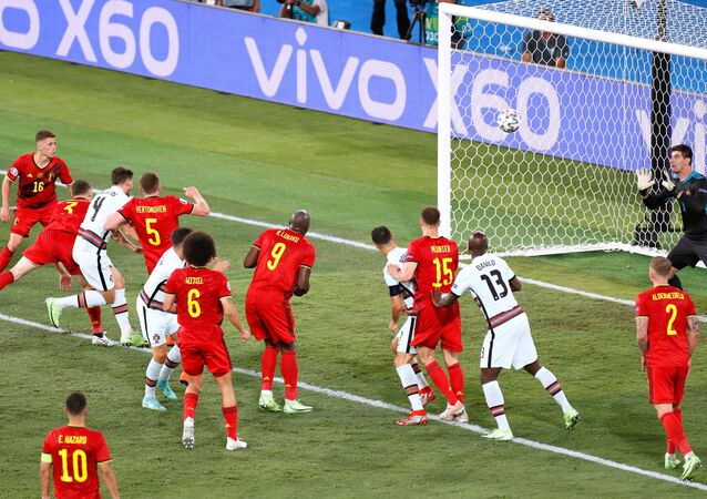 Portugal's Ruben Dias heads at goal