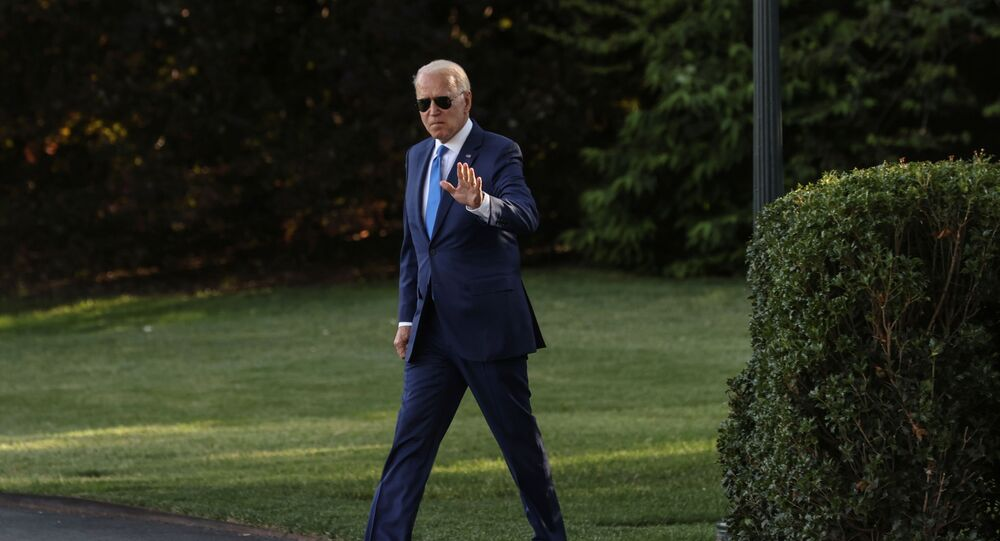 U.S. President Joe Biden waves as he walks to board the Marine One helicopter to depart for Camp David from the White House in Washington, U.S. June 25, 2021.