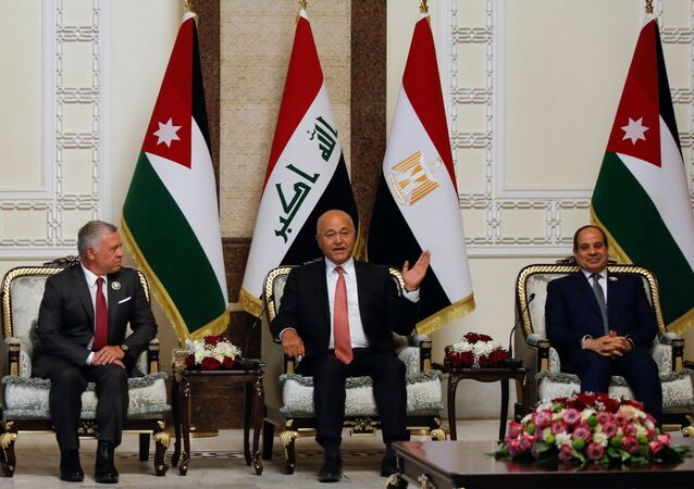 Iraqi President Barham Salih meets with King Abdullah II of Jordan and Egypt's President Abdel Fattah al-Sisi, in Baghdad, Iraq, June 27, 2021.