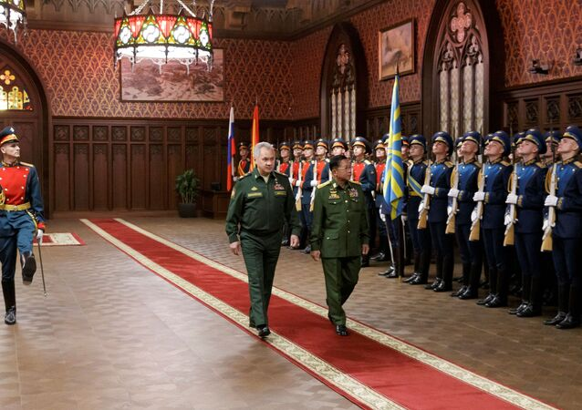 Russia's Defense Minister Sergei Shoigu and Myanmar's Commander in-Chief Senior General Min Aung Hlaing walk past the honour guard prior to their talks in Moscow, Russia June 22, 2021.