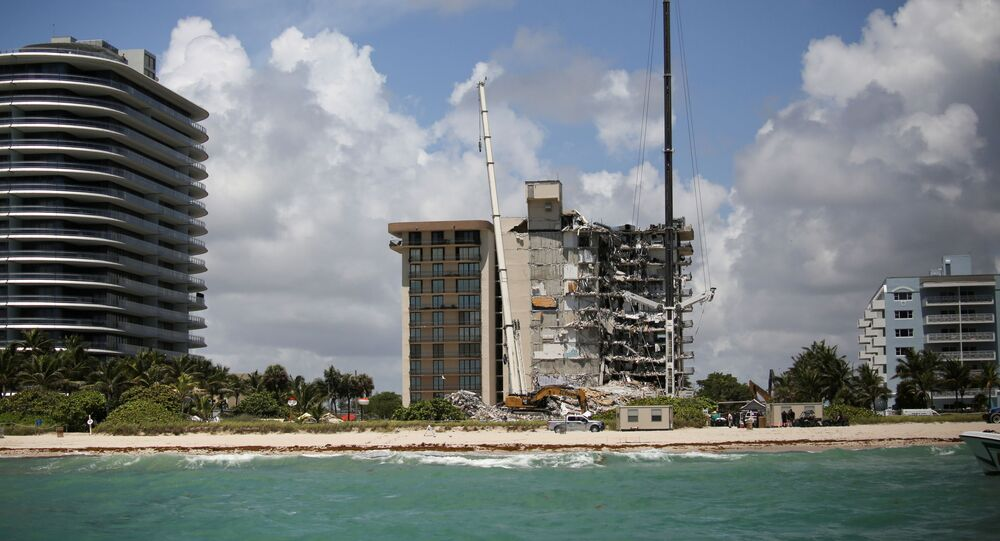 A general view of a partially collapsed residential building as the emergency crews continue search and rescue operations for survivors, in Surfside, near Miami Beach, Florida, U.S. June 27, 2021.
