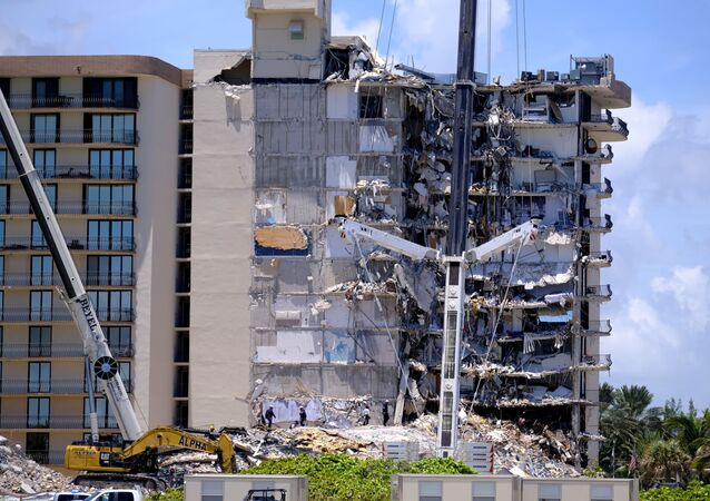 Search and rescue personnel continue searching for victims days after a residential building partially collapsed in Surfside near Miami Beach, Florida, U.S., 27 June 2021.