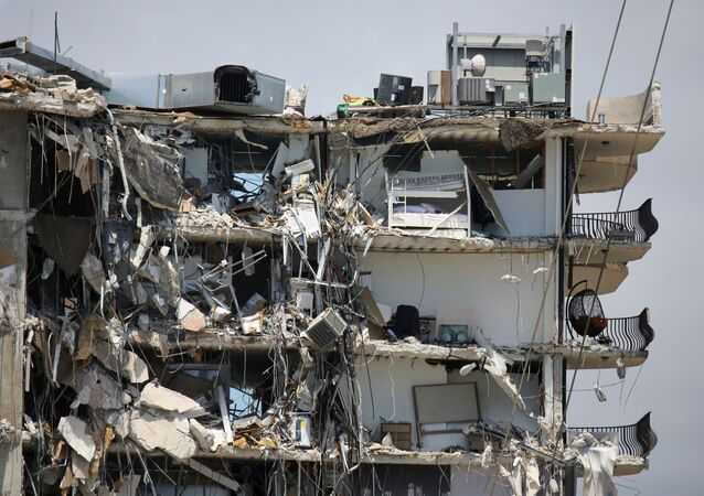 A view of a partially collapsed residential building as the emergency crews continue search and rescue operations for survivors, in Surfside, near Miami Beach, Florida, U.S. June 27, 2021