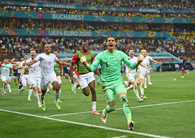 Soccer Football - Euro 2020 - Round of 16 - France v Switzerland - National Arena Bucharest, Bucharest, Romania - June 29, 2021   Switzerland's Yann Sommer celebrates after saving a penalty from France's Kylian Mbappe to win the shoot-out