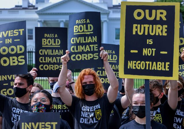 The Sunrise Movement demonstrate outside the White House demanding action on climate change and green jobs in Washington
