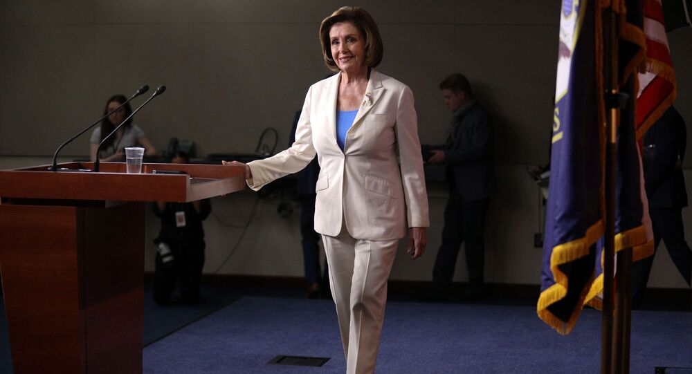 U.S. Speaker of the House Nancy Pelosi walks on stage before her remarks during a weekly news conference on Capitol Hill in Washington, U.S., June 24, 2021