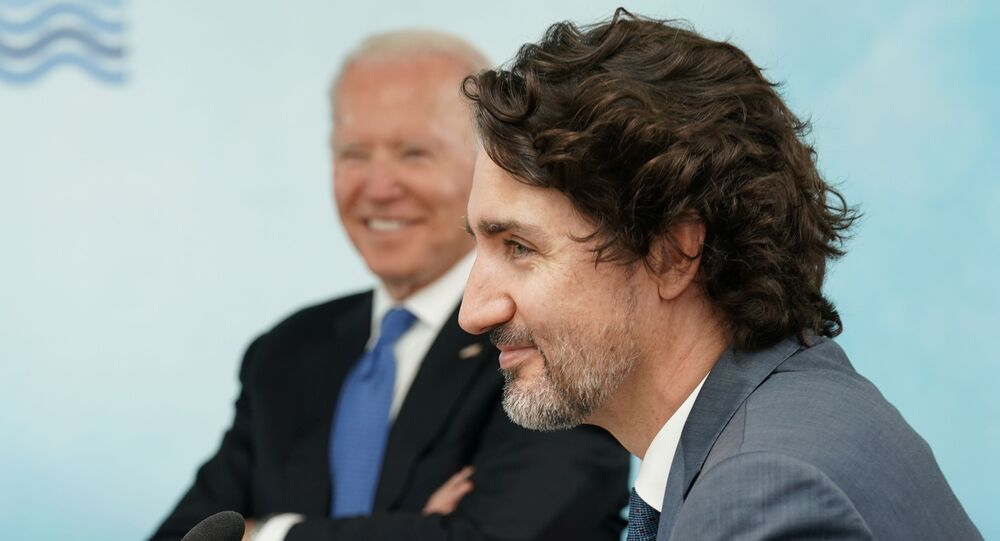 U.S. President Joe Biden and Canada's Prime Minister Justin Trudeau attend a session during the G7 summit in Carbis Bay, Cornwall, Britain, June 11, 2021
