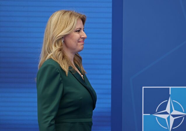 Slovakia's President Zuzana Caputova arrives to pose with NATO Secretary General Jens Stoltenberg (not pictured) during the NATO summit at the Alliance's headquarters, in Brussels, Belgium, June 14, 2021. Kenzo Tribouillard/Pool via REUTERS