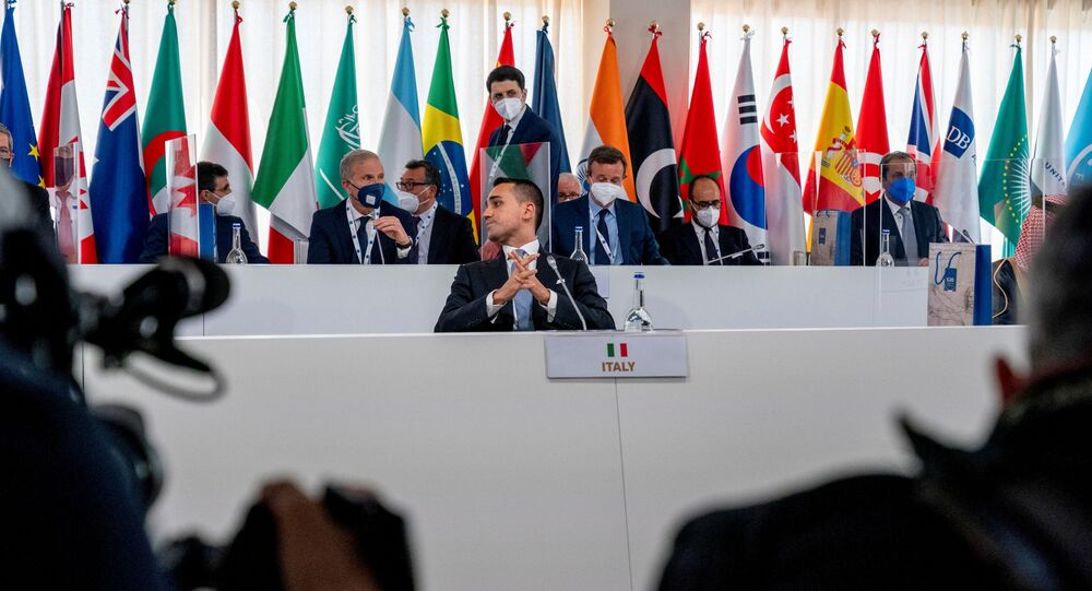 Italy's Foreign Minister Luigi Di Maio sits down to begin a G20 foreign ministers meeting in Matera, Italy June 29, 2021.