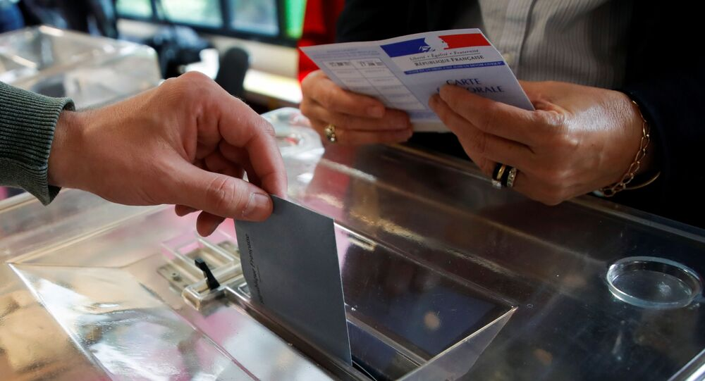 A person casts a vote at a polling station during the second round of French regional and departmental elections, in Velizy-Villacoublay, France June 27, 2021.
