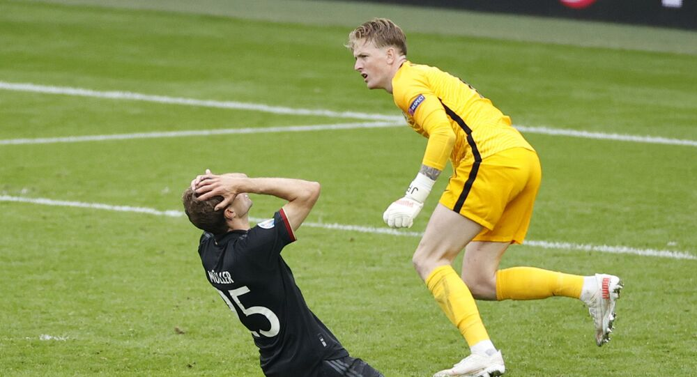 Euro 2020 - Round of 16 - England v Germany - Wembley Stadium, London, Britain - June 29, 2021 Germany's Thomas Mueller reacts after a missed chance as England's Jordan Pickford