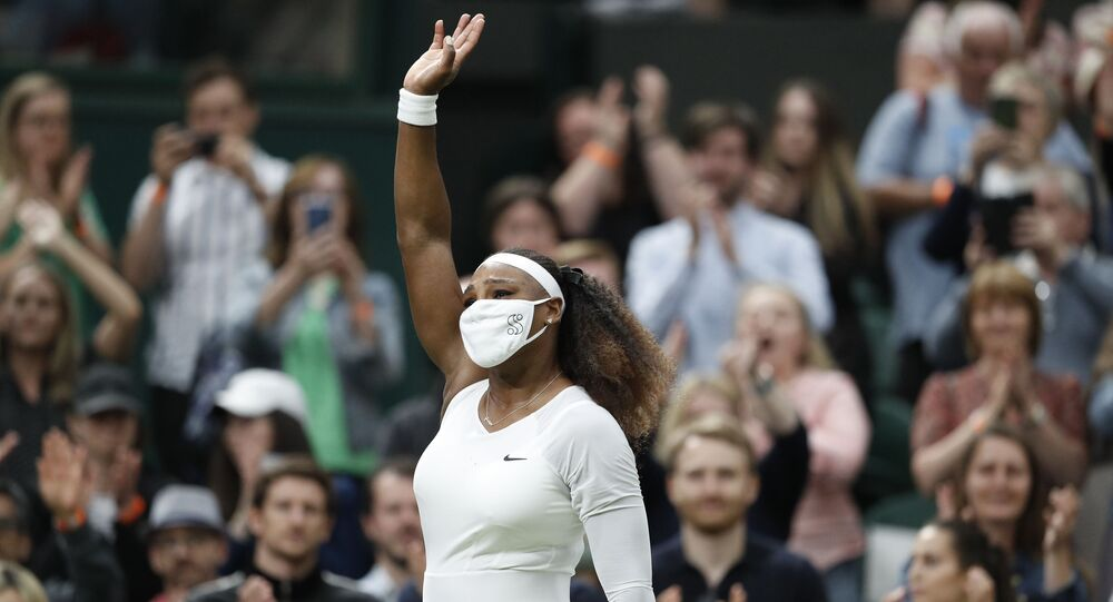 Tennis - Wimbledon - All England Lawn Tennis and Croquet Club, London, Britain - June 29, 2021 Serena Williams of the U.S. leaves court as she retires from her first round match against Belarus' Aliaksandra Sasnovich after sustaining an injury