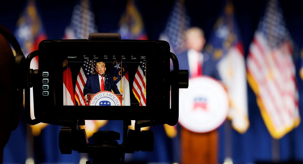Former U.S. President Donald Trump is seen in a live television monitor as he speaks at the North Carolina GOP convention dinner in Greenville, North Carolina, U.S. June 5, 2021