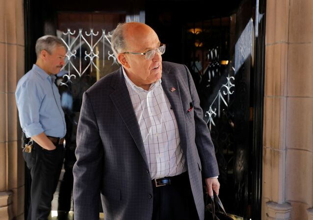 Former New York City Mayor Rudy Giuliani exits his apartment building after his law license was suspended in Manhattan in New York City, New York, U.S., June 24, 2021