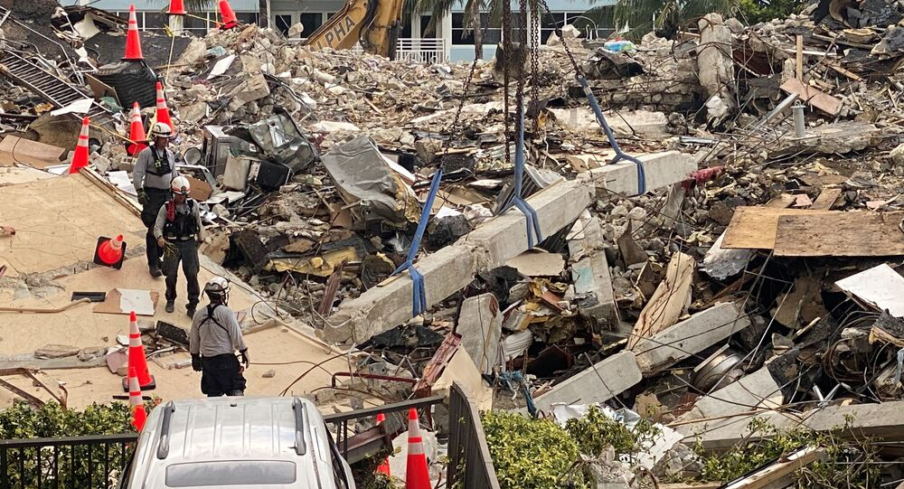 Members of the Urban Search and Rescue Florida Task Force 3 heavy rigging team work at the site of a partially collapsed residential building in Surfside, near Miami Beach, Florida, June 28, 2021