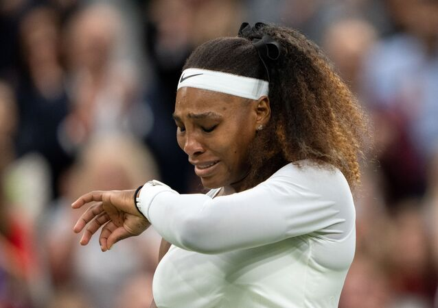 Tennis - Wimbledon - All England Lawn Tennis and Croquet Club, London, Britain - June 29, 2021 Serena Williams of the U.S. reacts after sustaining an injury before retiring from her first round match against Belarus' Aliaksandra Sasnovich