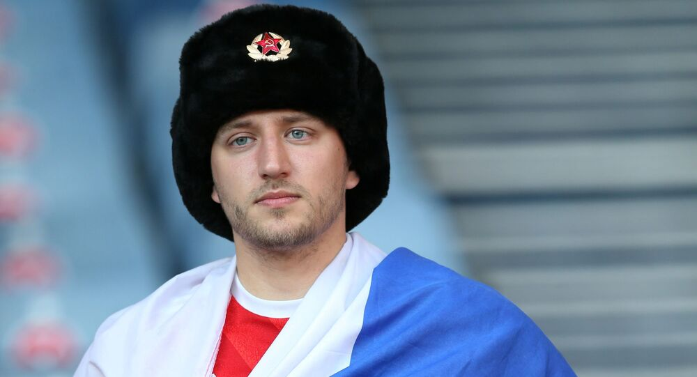 Fan with Russian flag in the stands before the match