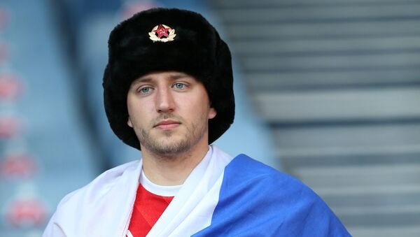 Fan with Russian flag in the stands before the match - Sputnik International