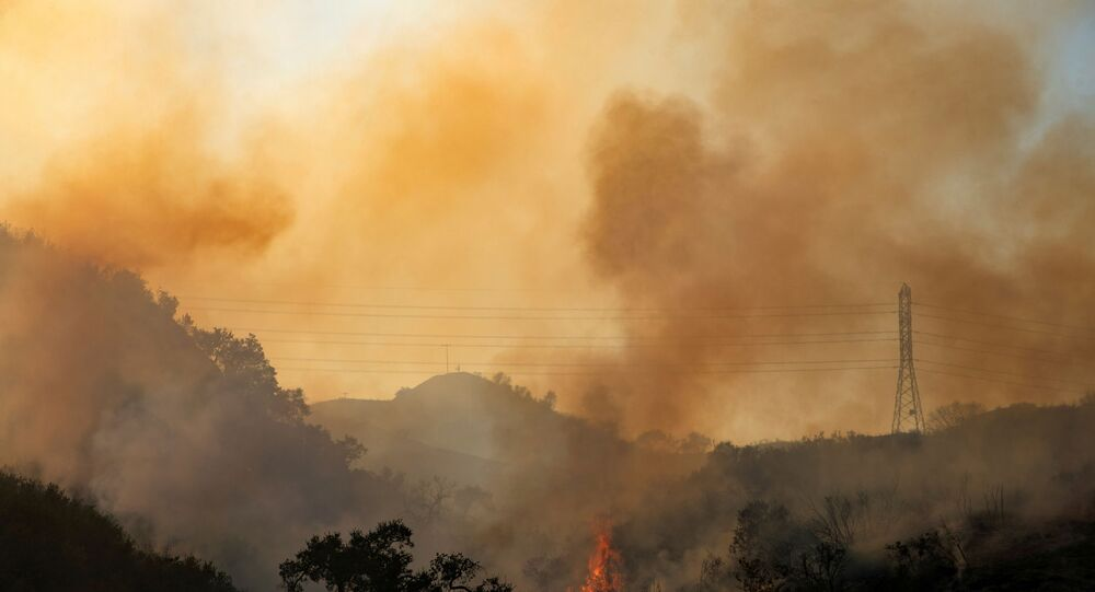 The Bond Fire wildfire continues to burn next to electrical power lines near Modjeska Canyon, California, U.S., December 3, 2020.