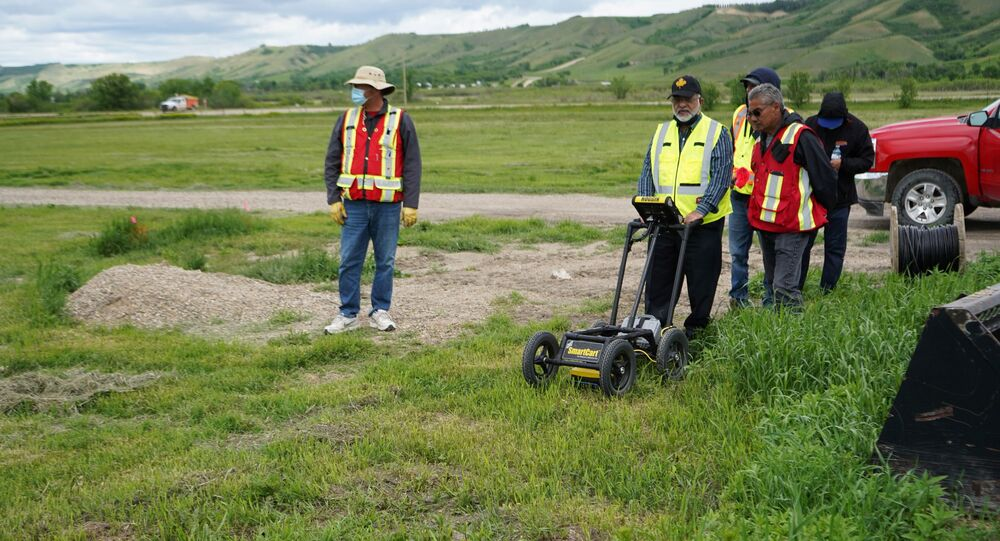 A crew performs a ground-penetrating radar search of a field, where the Cowessess First Nation said they had found 751 unmarked graves, near the former Marieval Indian Residential School in Grayson, Saskatchewan, Canada June 18, 2021.
