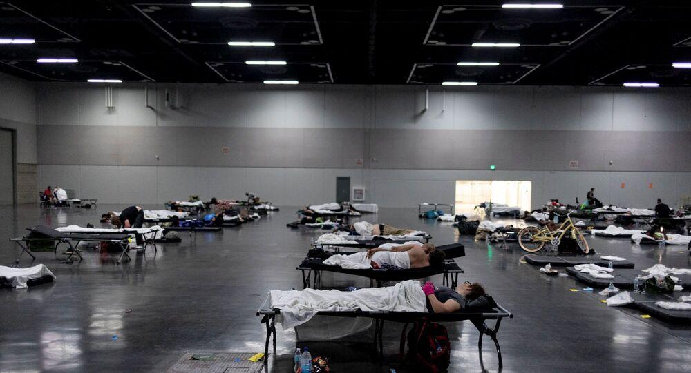 People sleep at a cooling shelter set up during an unprecedented heat wave in Portland, Oregon, U.S. June 27, 2021.