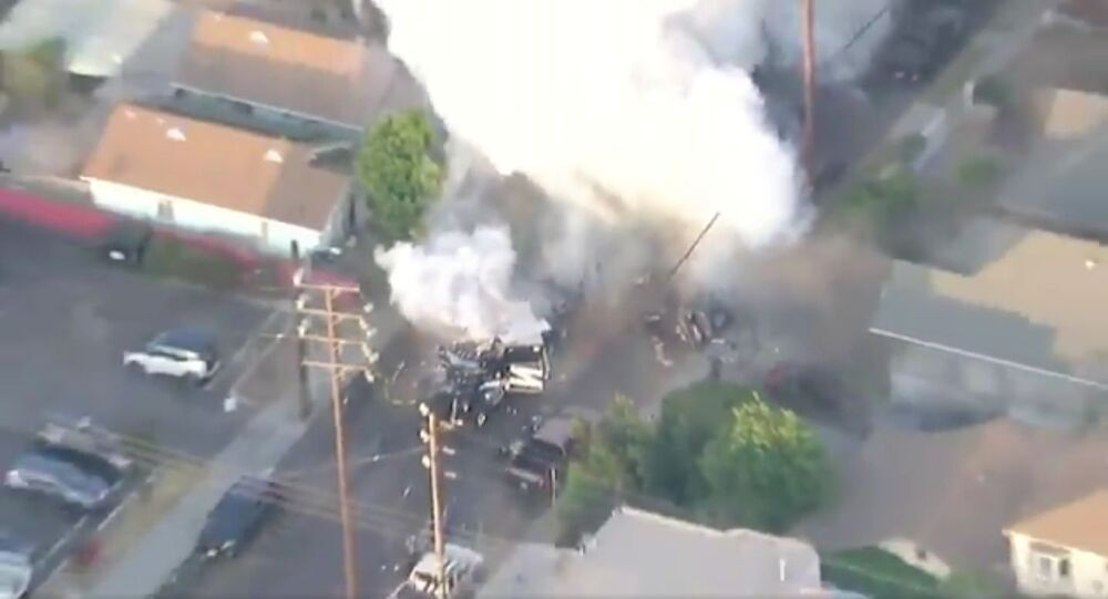 Ariel footage of LAPDHQ  setting off an explosion in South LA