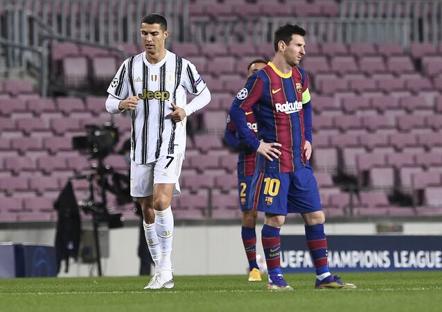 Juventus' Portuguese forward Cristiano Ronaldo (L) walks past Barcelona's Argentinian forward Lionel Messi during the UEFA Champions League group G football match between Barcelona and Juventus at the Camp Nou stadium in Barcelona on December 8, 2020