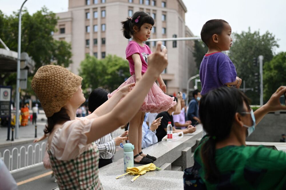 Kids are watching grand parade as the second largest party in the world is getting ready to step into the next century of its activities.