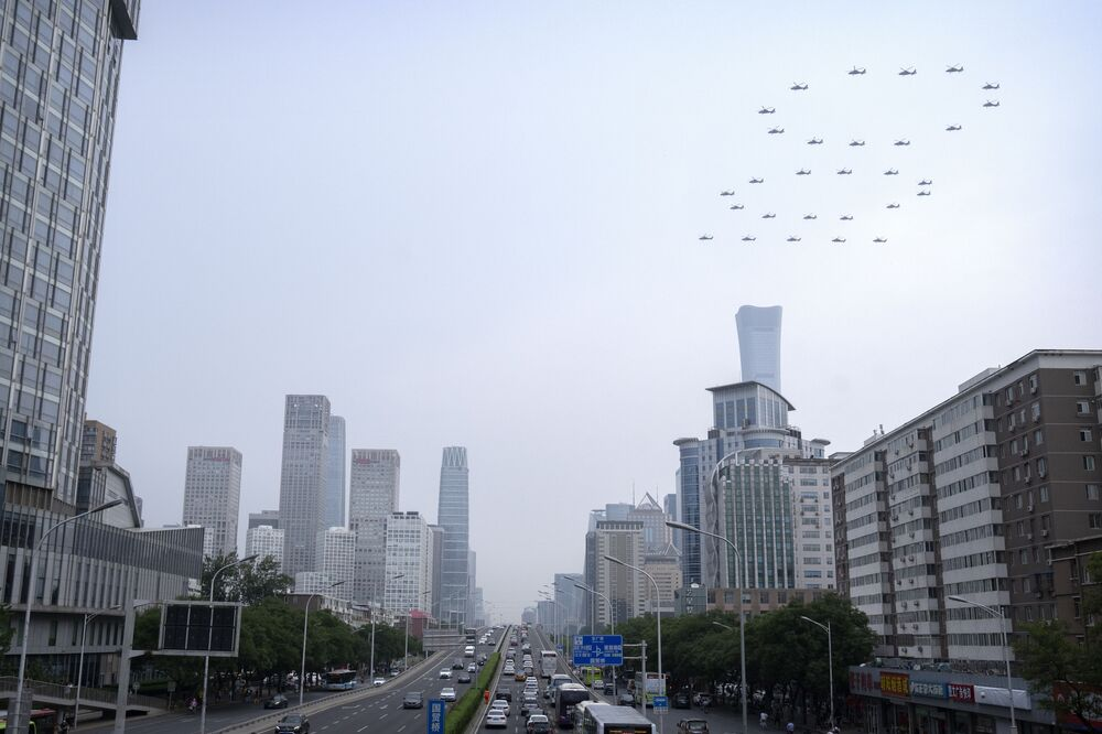 Chinese military helicopters are forming the number 100 in the sky.