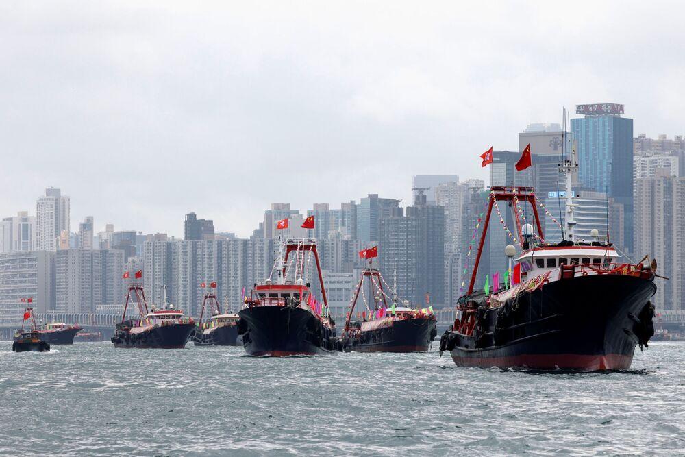 Fishing boats near Hong Kong fly the Chinese flag.