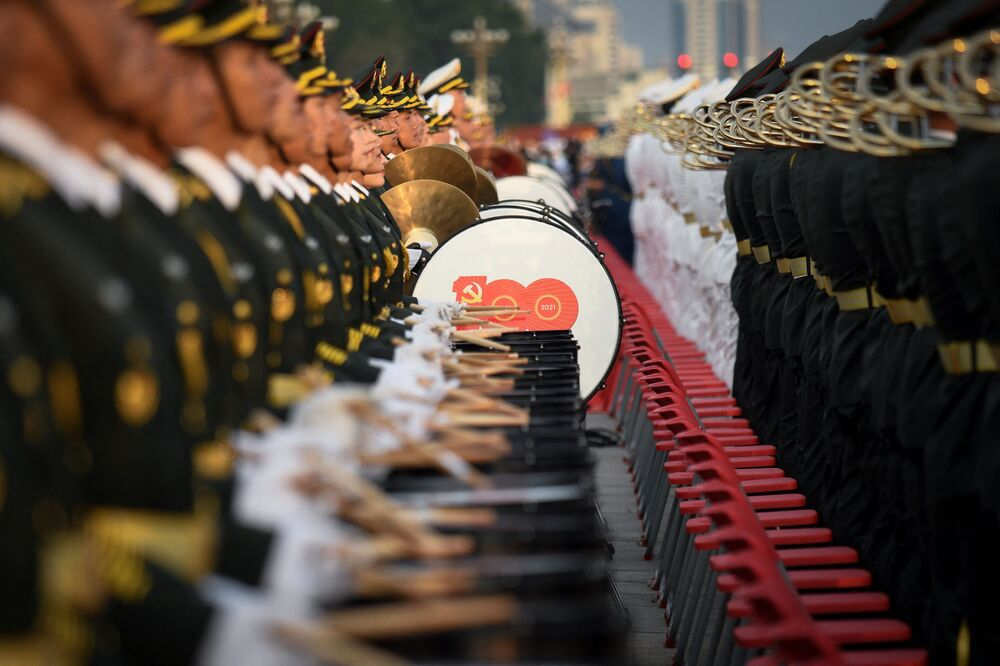 Military band's percussionists are standing still.